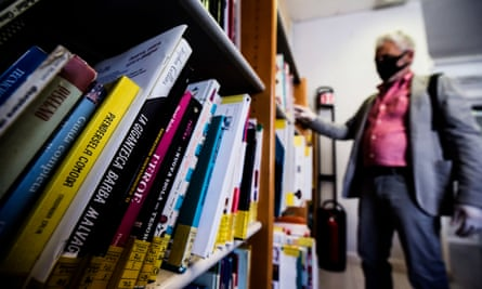 A librarian puts some books in the municipal library of Rome