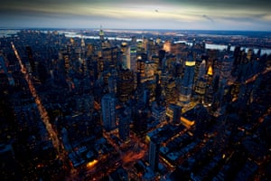 An aerial view of Manhattan at night which shows the Empire State and Chrysler buildings. It is part of a collection for a book, New York at Night by British photographer Jason Hawkes.