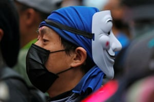 Protesters wearing masks gather during Sunday's anti-government rally at Causeway Bay.