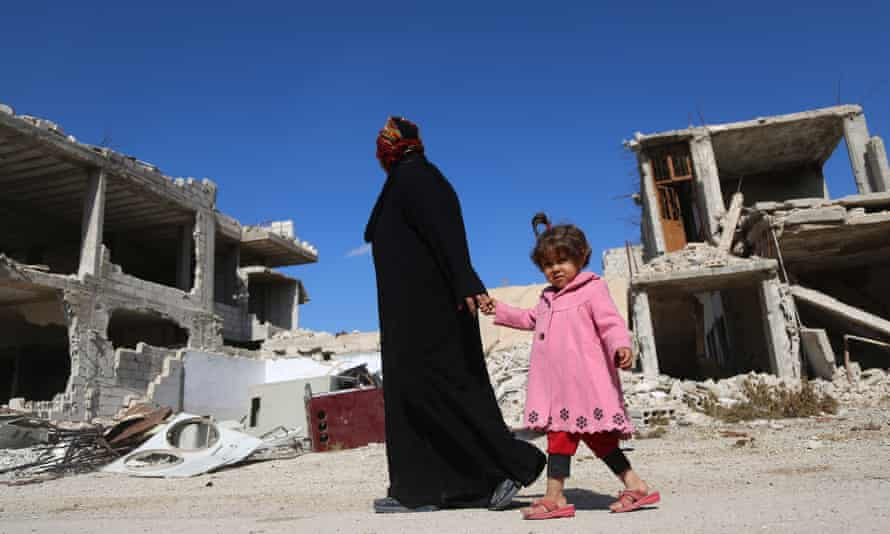 A Syrian woman and her daughter in Al-Nashabiyah in the besieged rebel-held Eastern Ghouta region outside Damascus.