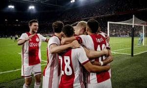 Dusan Tadic (No 10) celebrates with his Ajax teammates after scoring from the spot.