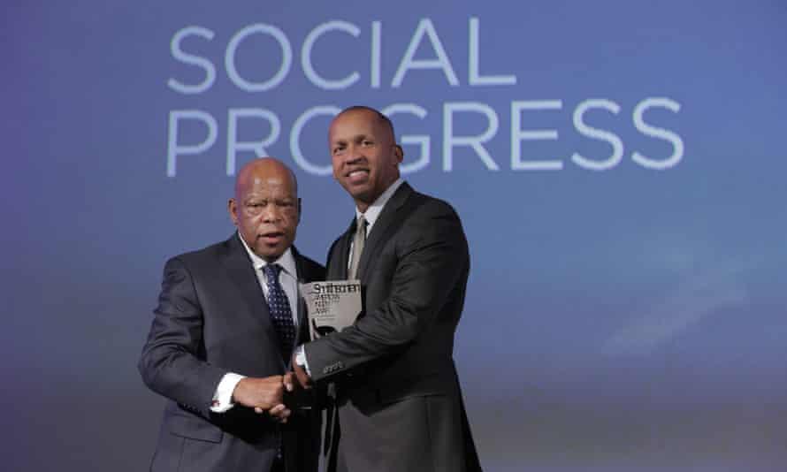 John Lewis presenting Bryan Stevenson with the Smithsonian Magazine's American Ingenuity award for social progress in 2012.