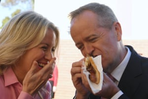 Who ate it best? Labor leader Bill Shorten and his wife Chloe eat a democracy sausage after casting their votes in Melbourne.