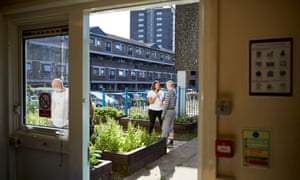 A caseworker teaches Rochdale residents about gardening, part of the Citizens' Curriculum.