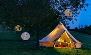 At night, an illuminated tent at the glampsite at Lloyds Meadow, Cheshire.