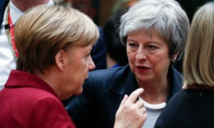 Angela Merkel and Theresa May (right) at the EU summit in Brussels in December.