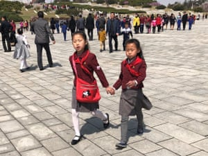Schoolchildren attend the Day of the Sun ceremony, an annual event on 15 April
