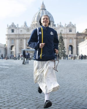 Nun Marie-Theo Manaudpose runs in front of St Peter's basilica at the Vatican.