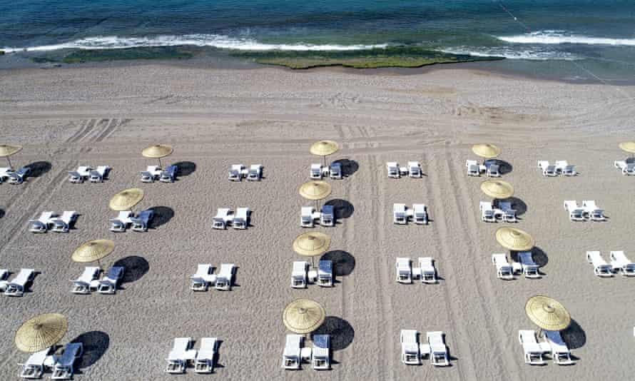 Empty sunbeds on beach