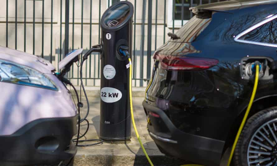 Cars being charged at an electric car charging point in central London