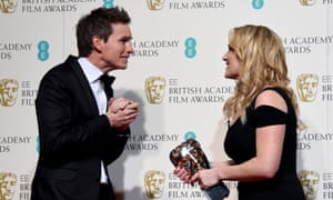 Kate Winslet chats with Eddie Redmayne in the press room after winning for the Best Supporting Actress award for 'Steve Jobs'