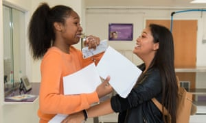 Elise Mouricette-Johnson and Jerusalem Benyam celebrate after collecting their GCSE results at Sion-Manning RC girls' school in west London.