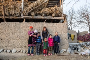 """Laila, 70, is raising four grandchildren. Their parents have been working in Russia for more than three years. Laila receives a monthly state pension of 3,400 Kyrgyz soms (about $50). """"Whenever a plane flies over us in the sky, the children ask me, 'Maybe it's our parents coming back?' And I tell them, 'Your parents will come, be patient.'"""" Djangijer village, Batken oblast."""