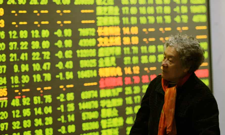 An investor checks stock information at a trading hall Hangzhou, China. The country's plunging shares sent shockwaves around the world.