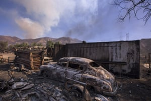 A charred vehicle in Little Tujunga Canyon in the path of the Creek fire near Sylmar