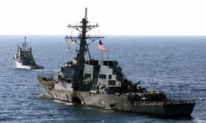 Military US Navy destroyer USS Cole is towed away from port city of Aden, Yemen, into open sea on 29 October 2000.