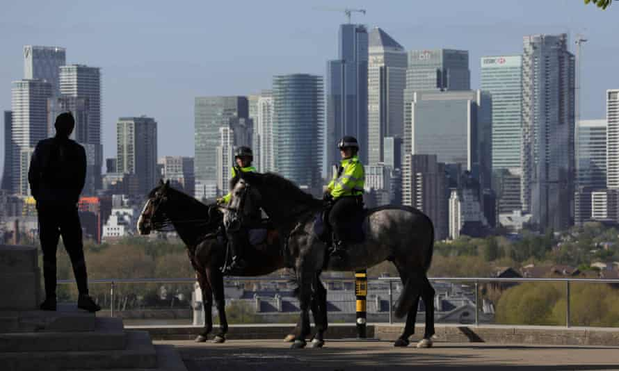 Police officers patrol Greenwich Park in London during lockdown.