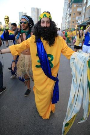 A Brazil fan dressed as Jesus Christ, with reference to Gabriel Jesus of Brazil