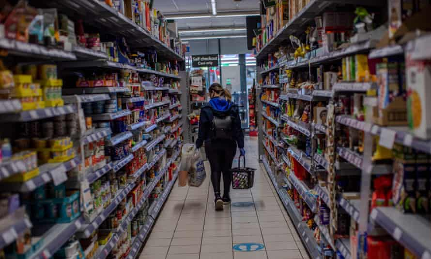 A woman shopping in the Co-op supermarket in West Norwood in May 2020.