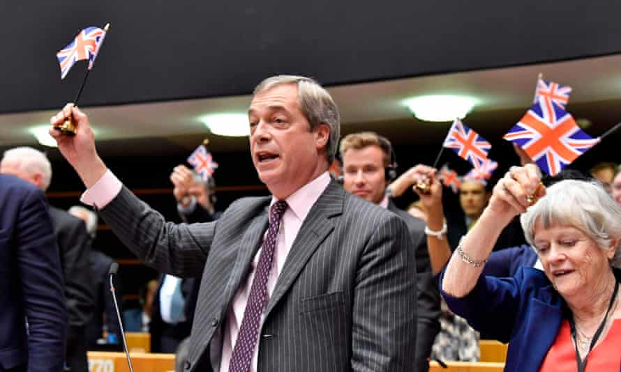 Nigel Farage holds up the union flag following the ratification of the Brexit deal at the European parliament, Brussels, 29 January 2020.