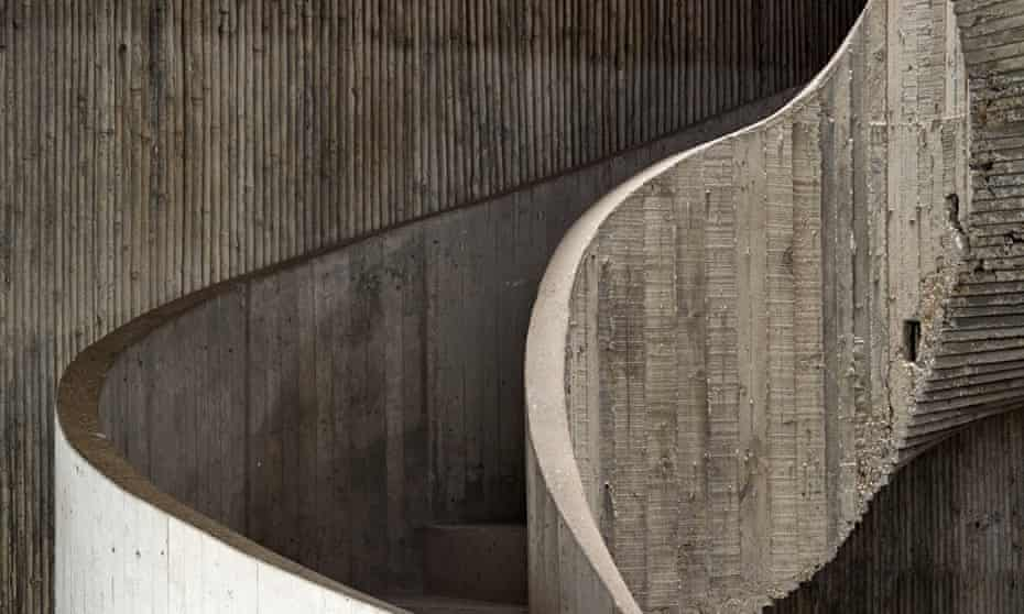 The winding concrete staircase.