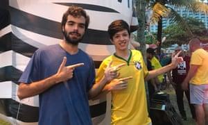 "Bernardo Arantes (left) and Bernardo Gorini show the ""gun gesture"" Bolsonaro and his supporters use"