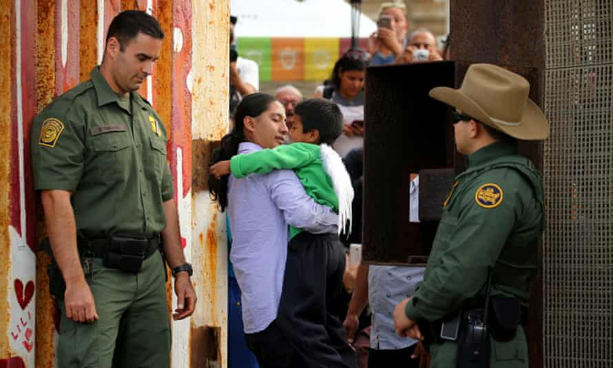 The border fence gate between US and Mexico is opened for a few hours to allow separated families to embrace as part of Universal Children's Day on 19 November 2016.