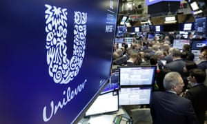 Unilever's logo above a trading post on the floor of the New York stock exchange.