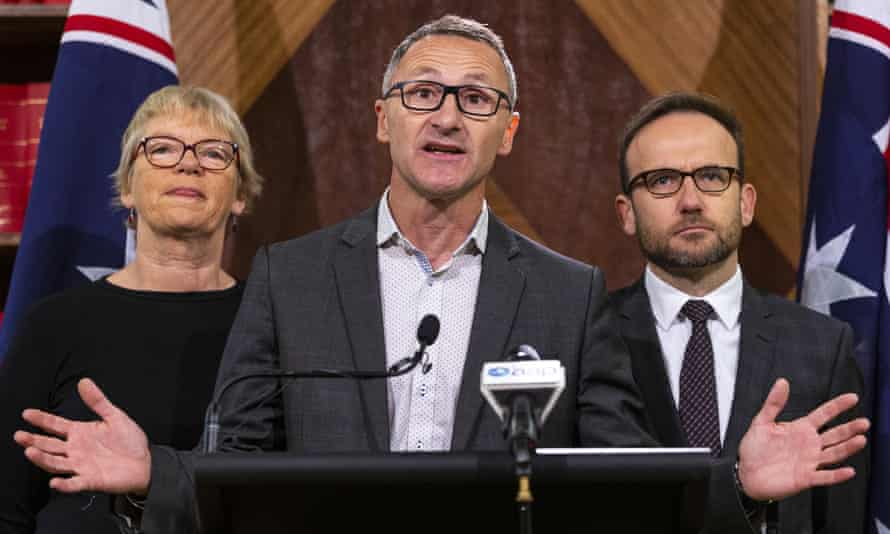 Greens leader Richard Di Natale speaks to the media alongside senator Janet Rice and MP Adam Bandt. The party has called for a $1.59bn reform of legal aid