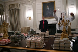 President Donald Trump talks to the press about the table full of fast food in the state dining room of the White House for a reception for the Clemson Tigers.