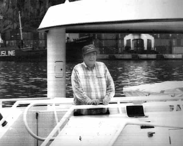 Robert Maxwell poses at the back of his yacht Lady Ghislaine.