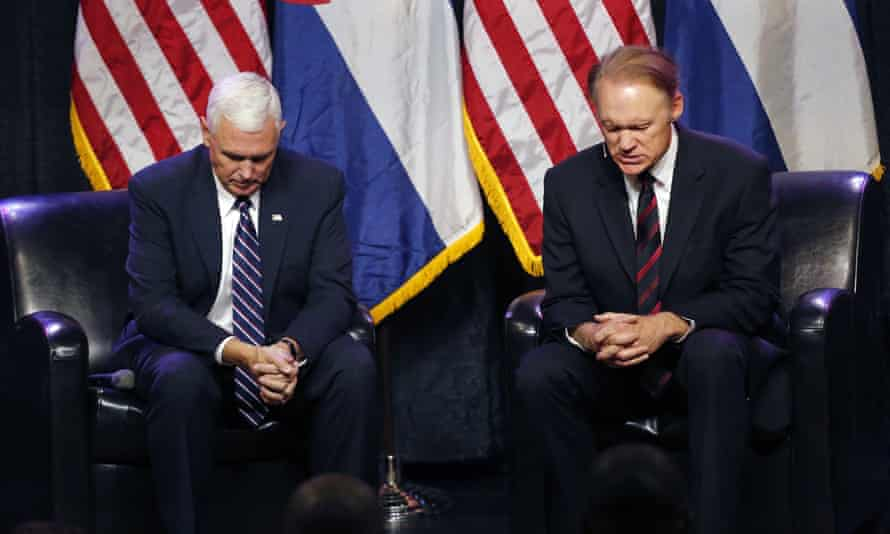 The Republican vice-presidential candidate, Mike Pence, left, prays with Todd Hudnall, pastor of Radiant church, at the start of a Pastor Roundtable in Colorado Springs, Colorado, on 22 September.