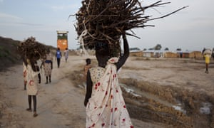 A young woman en route to the UN base outside Bentiu in Unity state, South Sudan, after collecting firewood