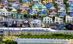 Flat-pack paradise … a bullet train passes through a suburb in Kanagawa, Japan.