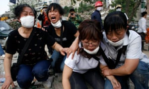 Survivors mourn the death of family members after a 7.9 magnitude earthquake struck Sichuan province in May 2008, killing almost 90,000 people.