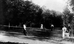 Leo Tolstoy (on near side of the net) on the tennis court.
