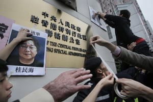 Protesters put up images of missing booksellers, one of which shows Gui Minhai, during a demonstration in Hong Kong.