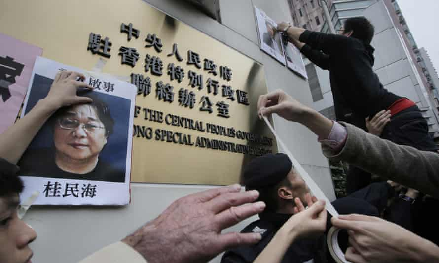 Gui Minhai's picture is displayed in a protest in Hong Kong against detentions in China.