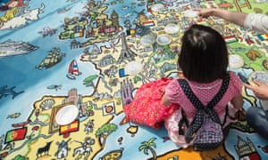 A girl and her mother play on a giant map of Europe at the EU Commission in Brussels, Belgium