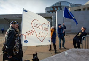 Anti-Brexit, pro-EU protesters begin to gather outside the Scottish parliament at Holyrood, Edinburgh