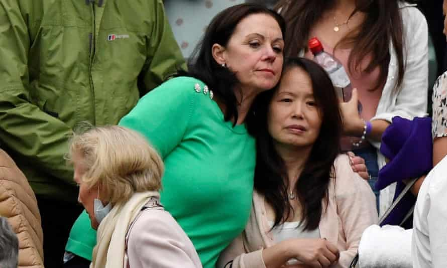 Emma's mother Renee Raducanu (right) is comforted as her daughter is helped by the court.