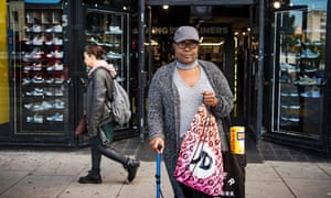 Maureen Os, 55, outside JD Sports's Holloway Road store. 'The things are reasonably priced in there,' she says of the sportswear shop. 'M&S is really grannified.'