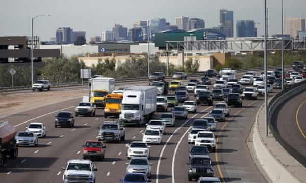 Early rush hour traffic rolls along I-10 in Phoenix.