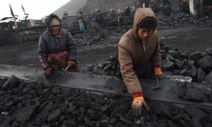 Workers sort coal on a conveyer belt at a coal mine in China. Deadly mining accidents are common in China, where the industry has a poor safety record.