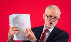 Jeremy Corbyn holding a copy of the dossier which Labour says proves the NHS would be 'on the table' in US-UK trade talks.