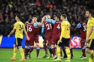 Despair for Arsenal as Ogbonna celebrates.