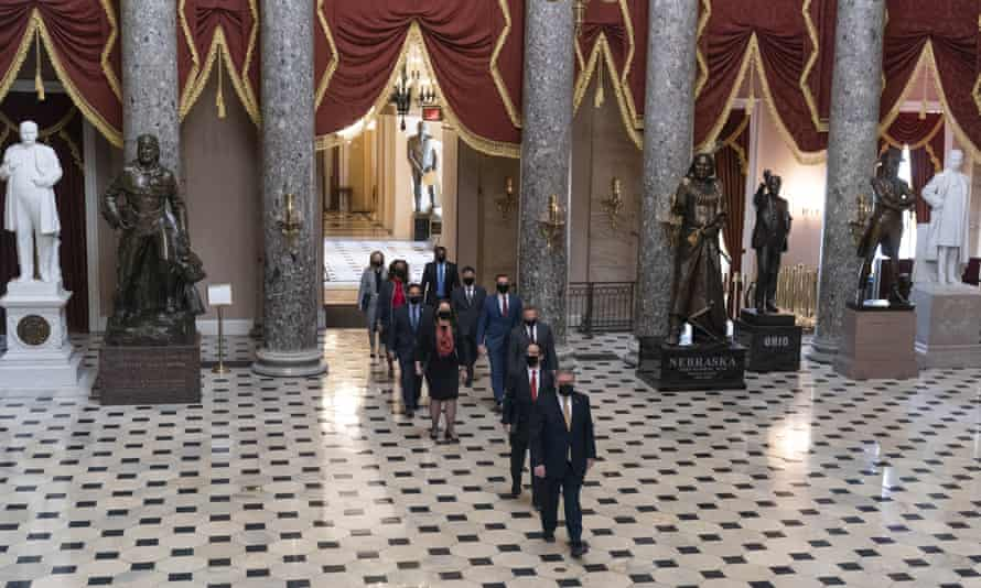 Timothy Blodgett, acting sergeant-at-arms, leads Congress members Jamie Raskin, David Cicilline, Diana DeGette, Joaquin Castro, Eric Swalwell, Ted Lieu, Stacey Plaskett, Madeline Dean and Joe Neguse to the Senate on 9 February.