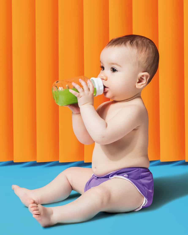 Baby drinking green juice