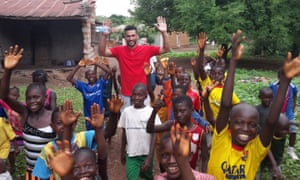 Steven Caulker meets some young fans on his visit to Sierra Leone in June.