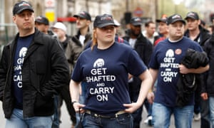 Off-duty police officers march in protest at funding cuts, May 2012.